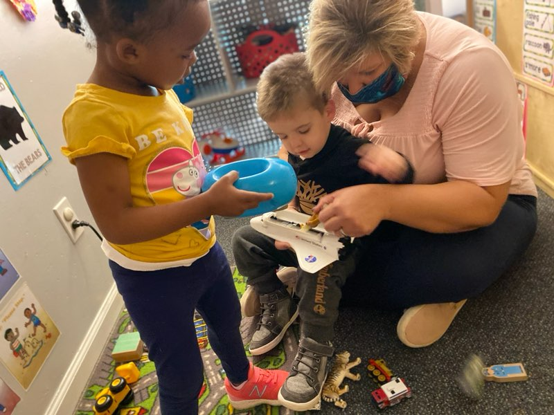 Early Childhood teacher working with toddlers
